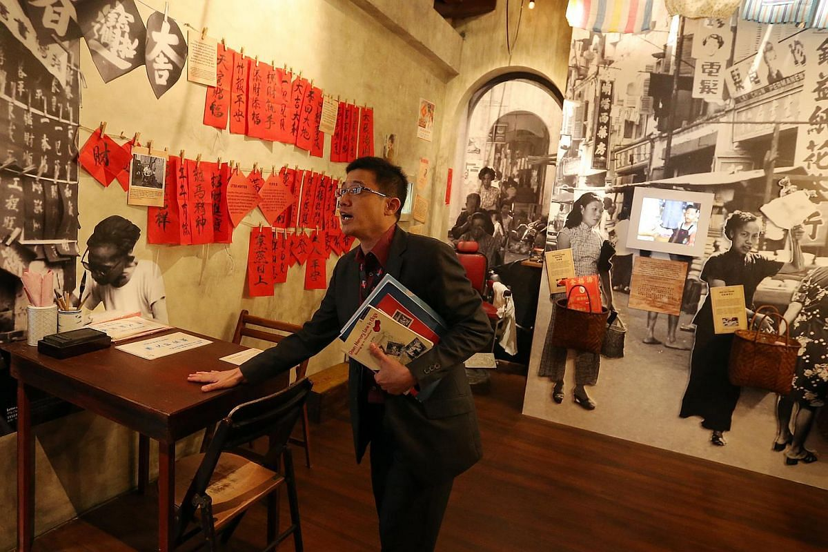 Mr Razeen Chan, manager for Research and Consultancy, Singapore History Consultants, shows the media the gallery that celebrates Chinatown of the 1960s.