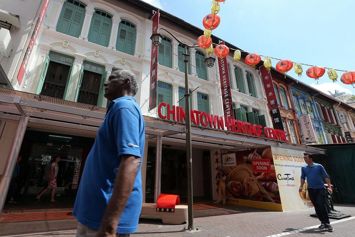Members of the public seen outside the newly revamped Chinatown Heritage Centre in three three-storey shophouses at 48 Pagoda Street.