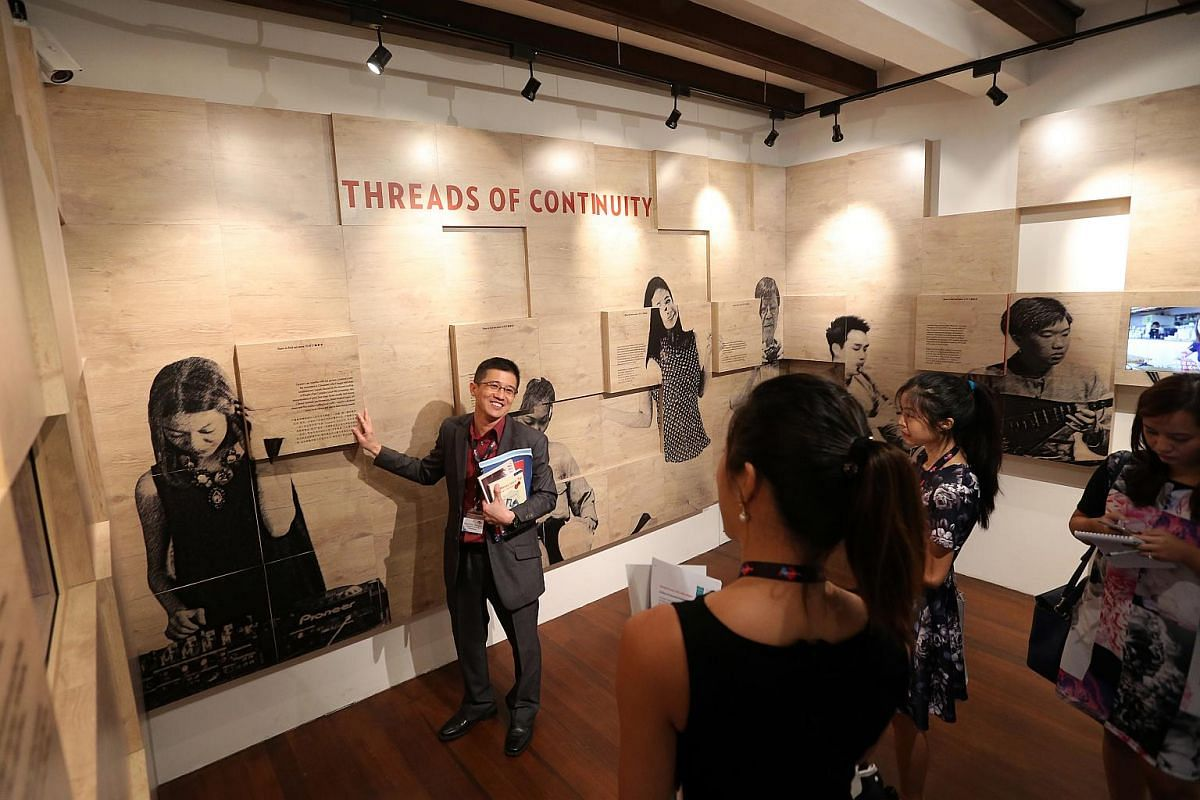 Mr Razeen Chan (left), manager for Research and Consultancy, Singapore History Consultants, shows the media a separate section featuring six personalities whose lives are entwined with the evolution of Chinatown.