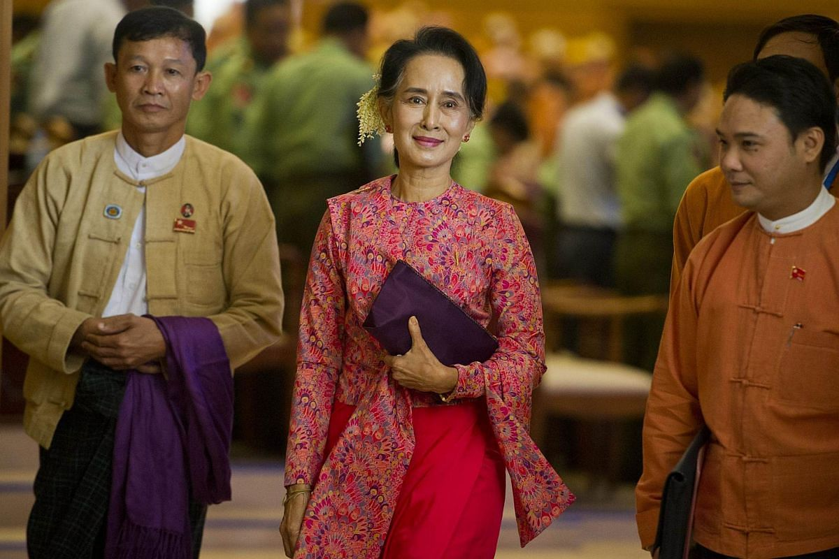Myanmar's National League for Democracy chairman Aung San Suu Kyi (centre) leaving after the new lower house parliamentary session in Naypyidaw on Feb 1, 2016.