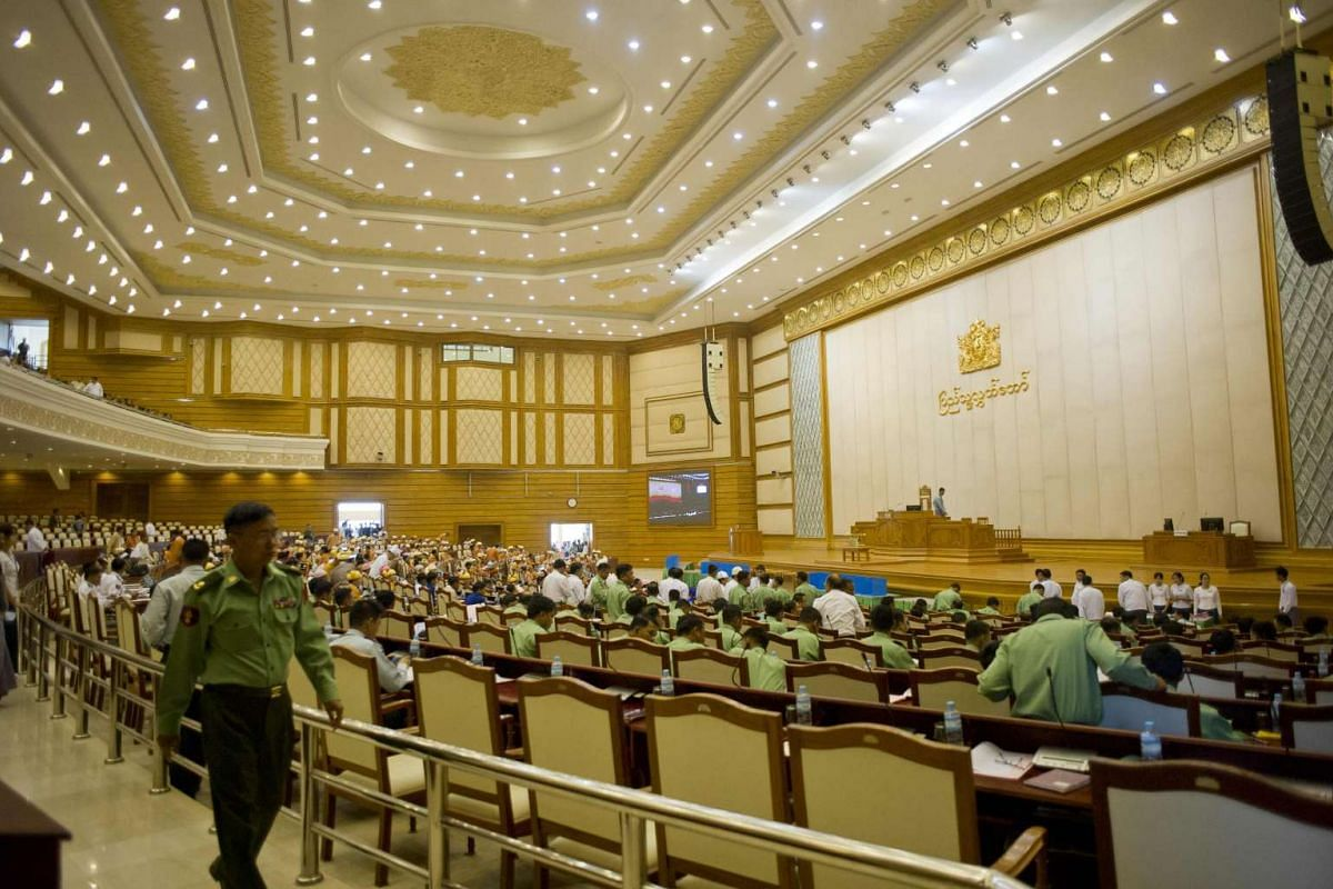 Myanmar MPs attend the new lower house parliamentary session on Feb 1, 2016.