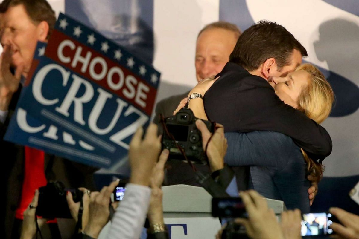 Republican presidential candidate Senator Ted Cruz embracing his wife Heidi in front of supporters at the caucus night gathering at the Iowa State Fairgrounds on Feb 1, 2016.
