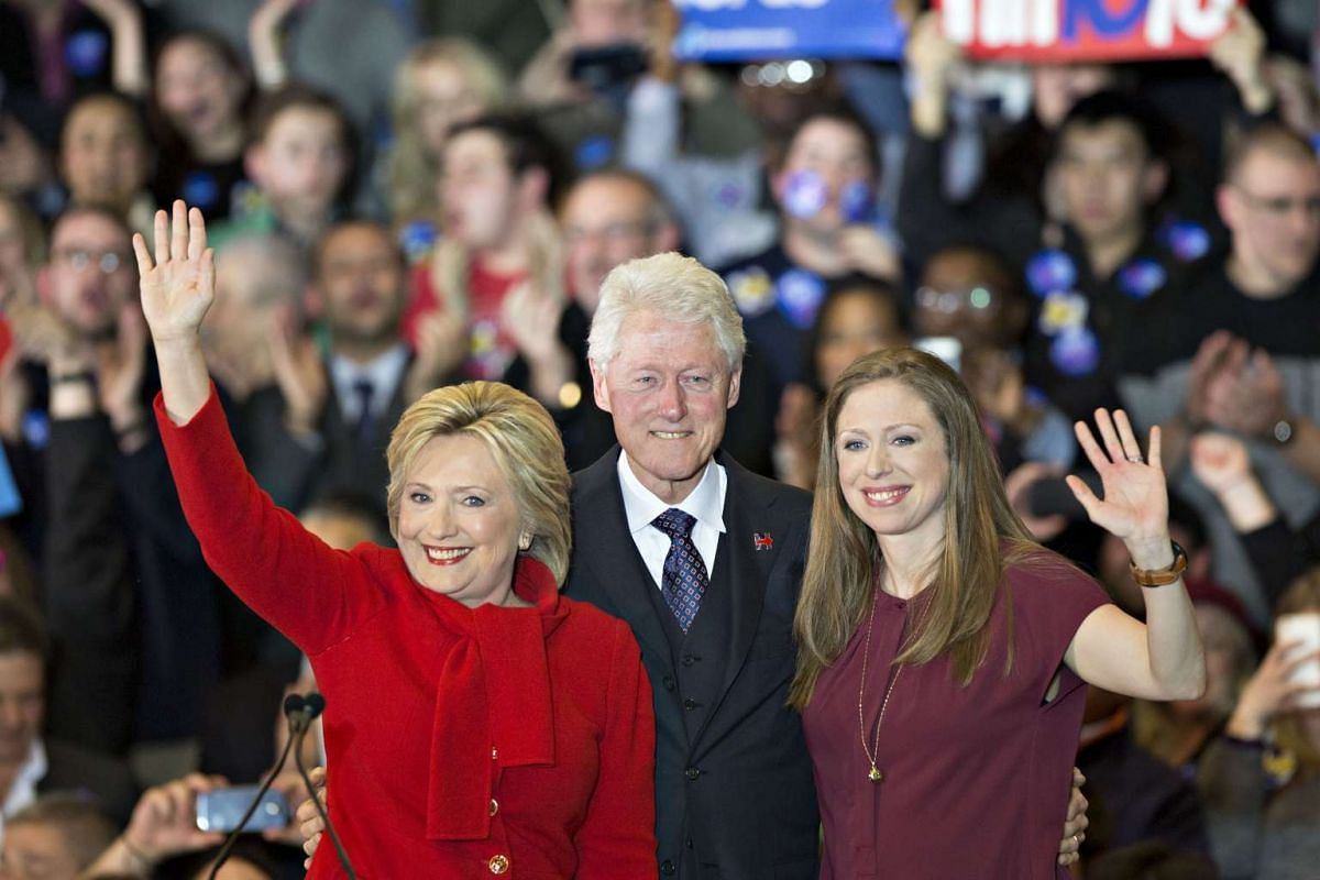 Democratic presidential candidate Hillary Clinton, her husband Bill Clinton and their daughter Chelsea Clinton waving during a caucus night party in Iowa on Feb 1, 2016.