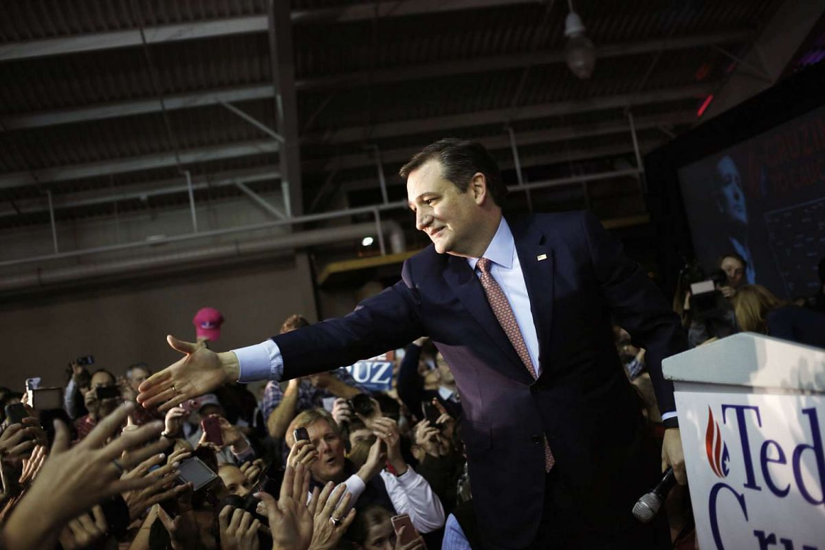 Republican presidential candidate Senator Ted Cruz greets supporters after being declared the winner of the Iowa caucus on Feb 1, 2016. He upset party frontrunner Donald Trump.