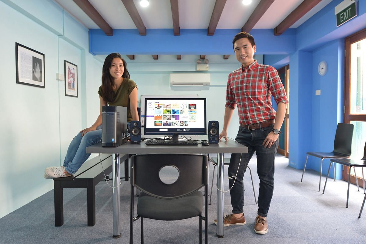 Centre 42's marketing and communications manager Ma Yanling, 32, and research and documentation executive Daniel Teo, 30, in its library, where the public can browse through scans of archived material.