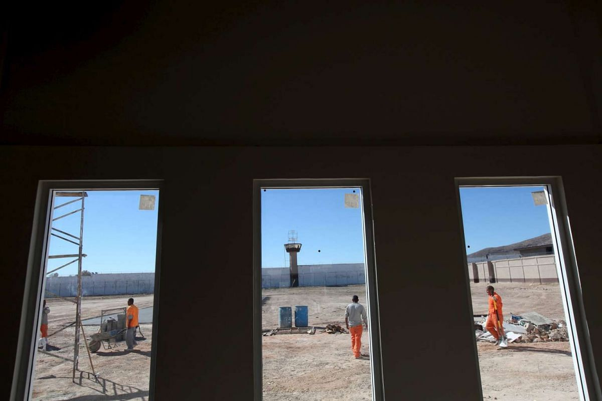 Inmates building a church for the visit of Pope Francis inside the Cereso 3 prison in Ciudad Juarez, Mexico, on Jan 29.