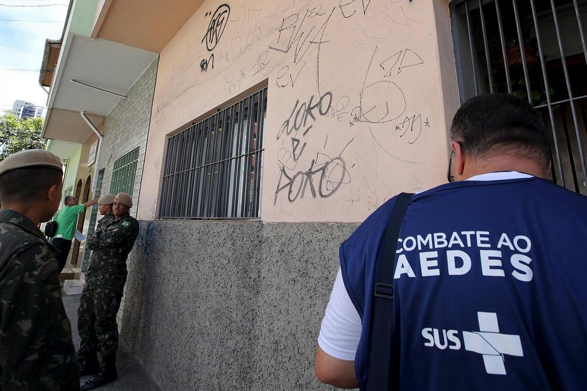 Brazilian soldiers (left) and health agents conduct an inspection for the Aedes aegypti mosquito as part of efforts to prevent the spread of the Zika virus.