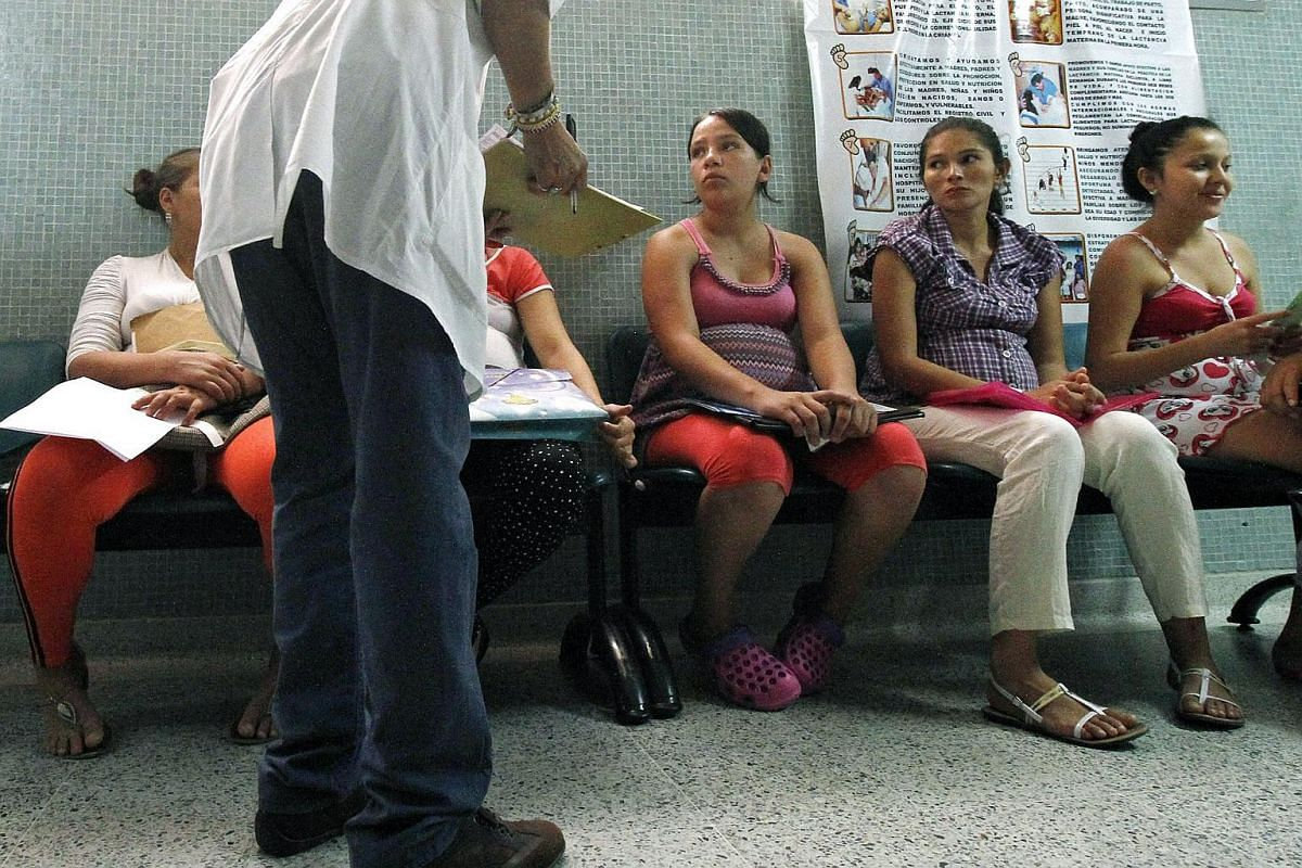 Sandra Milena Ovallos (third right), who is 25 weeks pregnant, takes a medical examination at a clinic in Colombia.