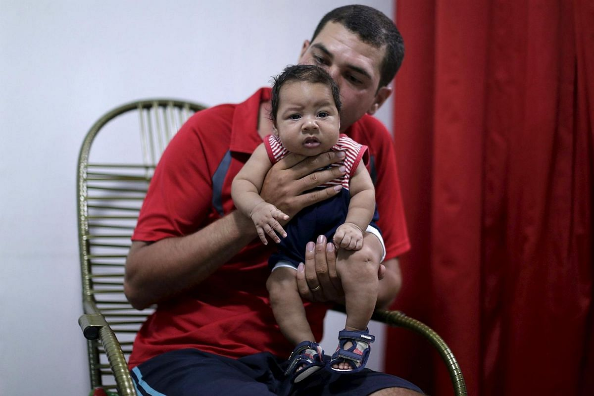 Glecion Fernando holds his two-month-old son Guilherme Soares Amorim, who was born with microcephaly, at their house in Ipojuca, Brazil.