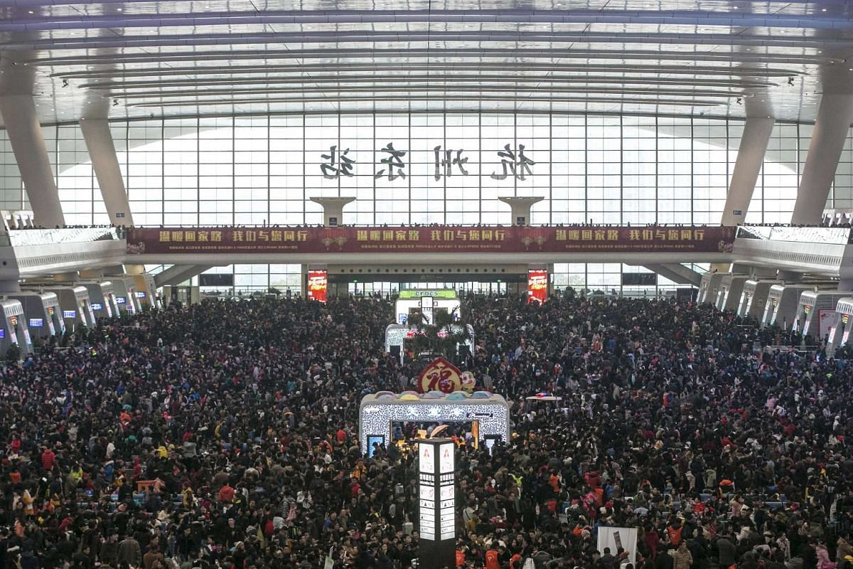Passengers crowd a waiting hall of a railway station after trains were delayed due to heavy snow.