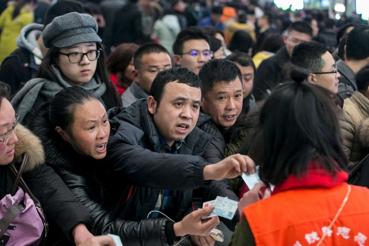 Passengers ask for refunds on their tickets after trains were delayed due to heavy snow, in Hangzhou, Zhejiang province.