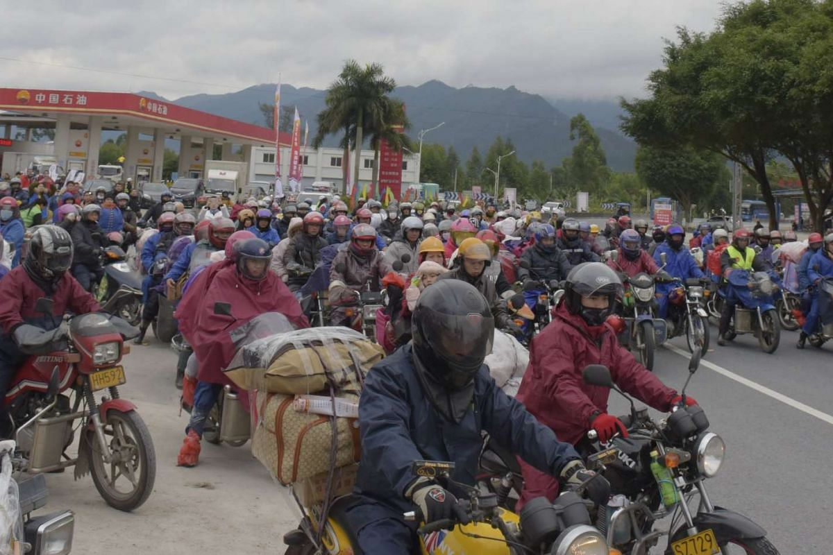 Motorcyclists ride on a highway as they head back to their hometowns ahead of the upcoming Spring Festival.