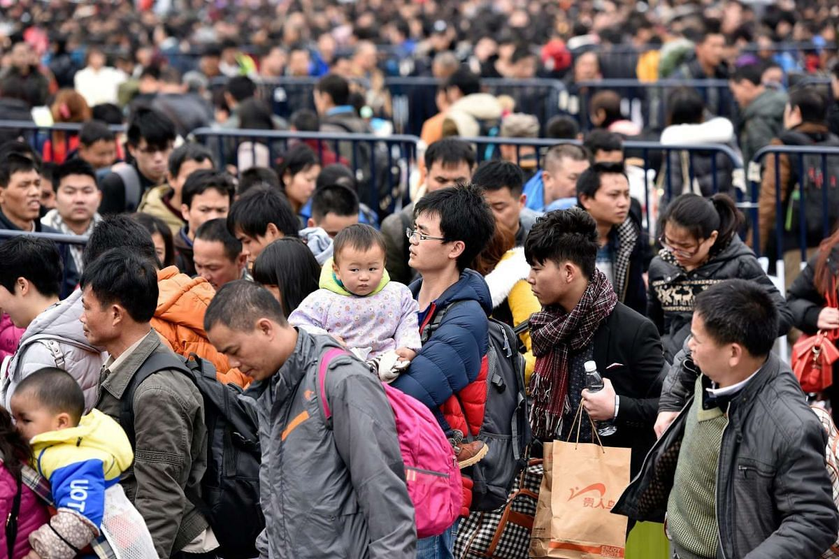 Passengers are seen stranded outside the Guangzhou Railway Station in Guangzhou in south China's Guangdong province.