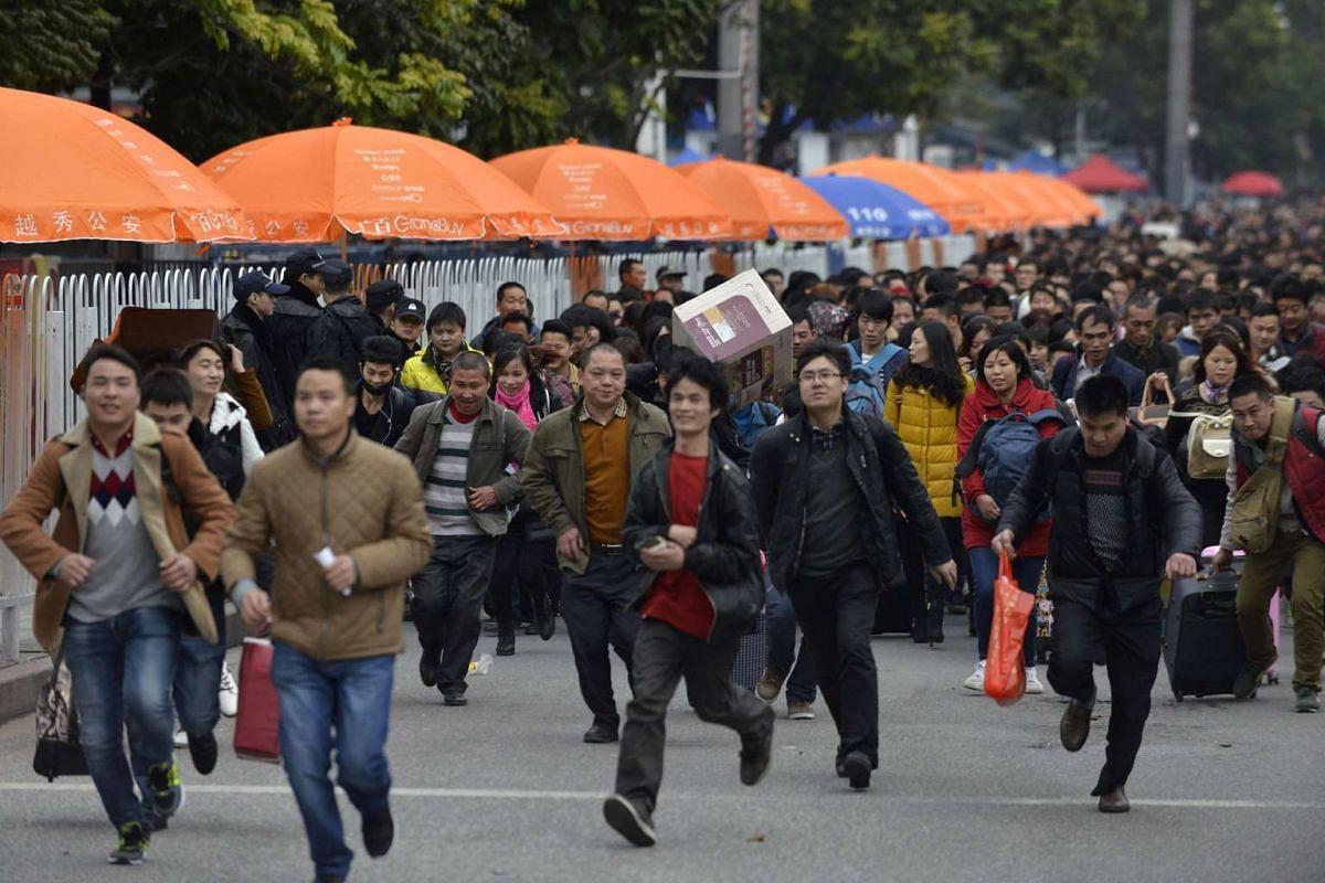Passengers rush to enter Guangzhou railway station in Guangzhou, in southern China's Guangdong province.