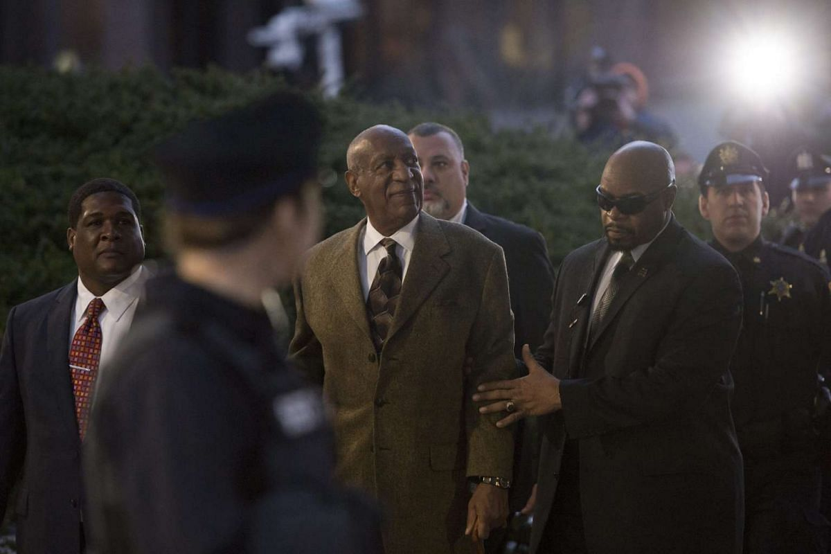 US entertainer Bill Cosby (centre) departing the Montgomery County Courthouse in Pennsylvaniaafter a hearing regarding alleged sexual assault charges, on Dec 30, 2015. Cosby is seeking to derail Pennsylvania prosecutors' effort to make him stand tr