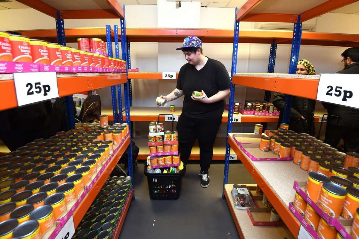 A customer shops in the new easyFoodstore budget supermarket in Park Royal, north London, Britain on Feb 3, 2016.