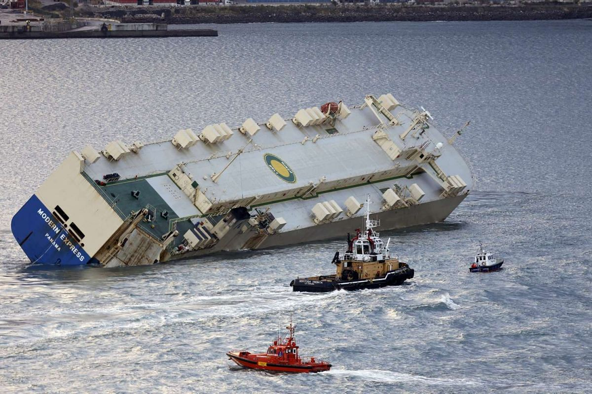 The stricken vessel Modern Express getting towed into the port of Bilbao, Spain, after a successful mission to prevent it from drifting and crashing into France's Atlantic coast, Feb 2, 2016.