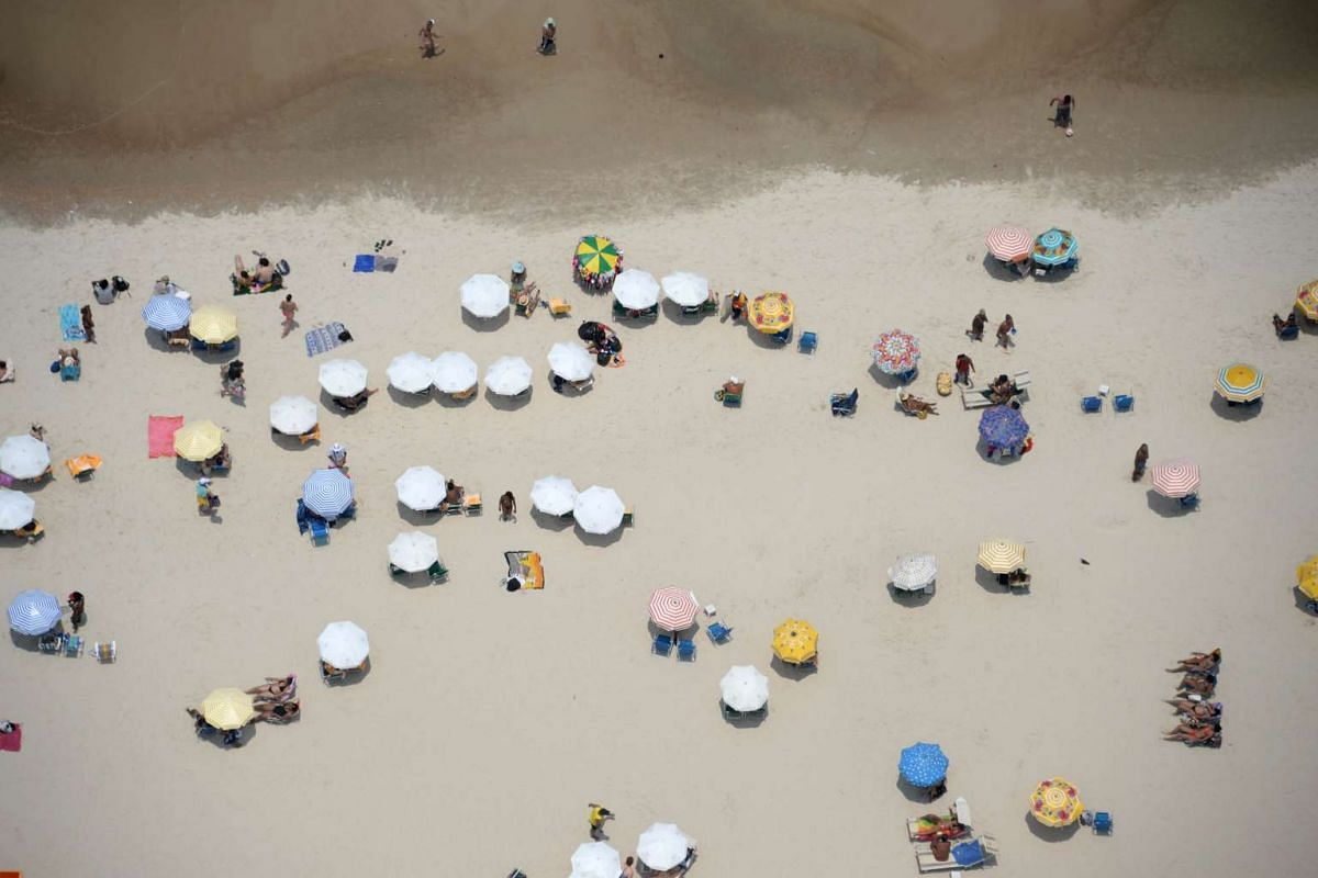 An aerial view of Copacabana Beach in Rio de Janeiro, Brazil on Feb 3, 2016, where people go to cool off from the heat.