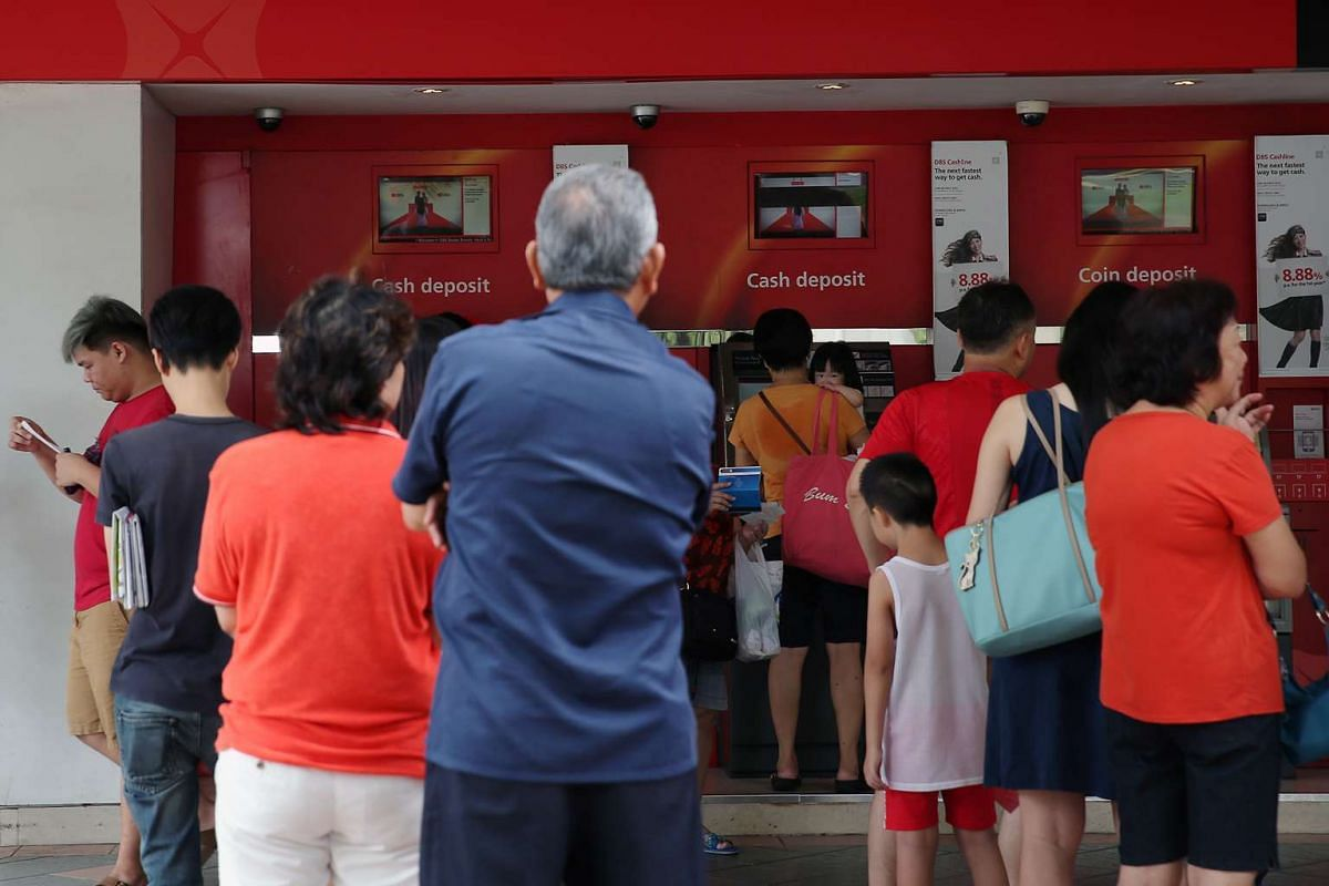 Members of the public queueing to deposit cash at banks in Bedok Town Centre on Feb 4, 2016.