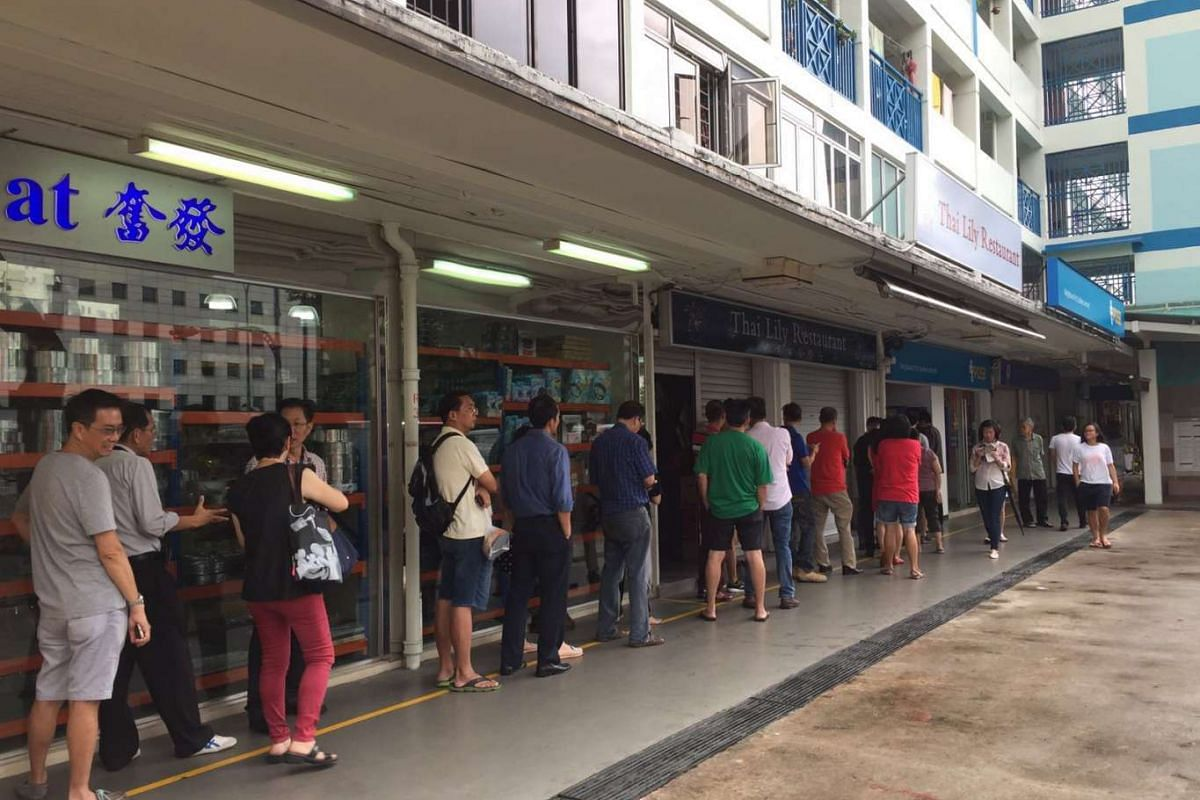 People queueing to deposit money on Li Chun at Toa Payoh Lor 1, which is considered an auspicious day, to help grow their luck and wealth.