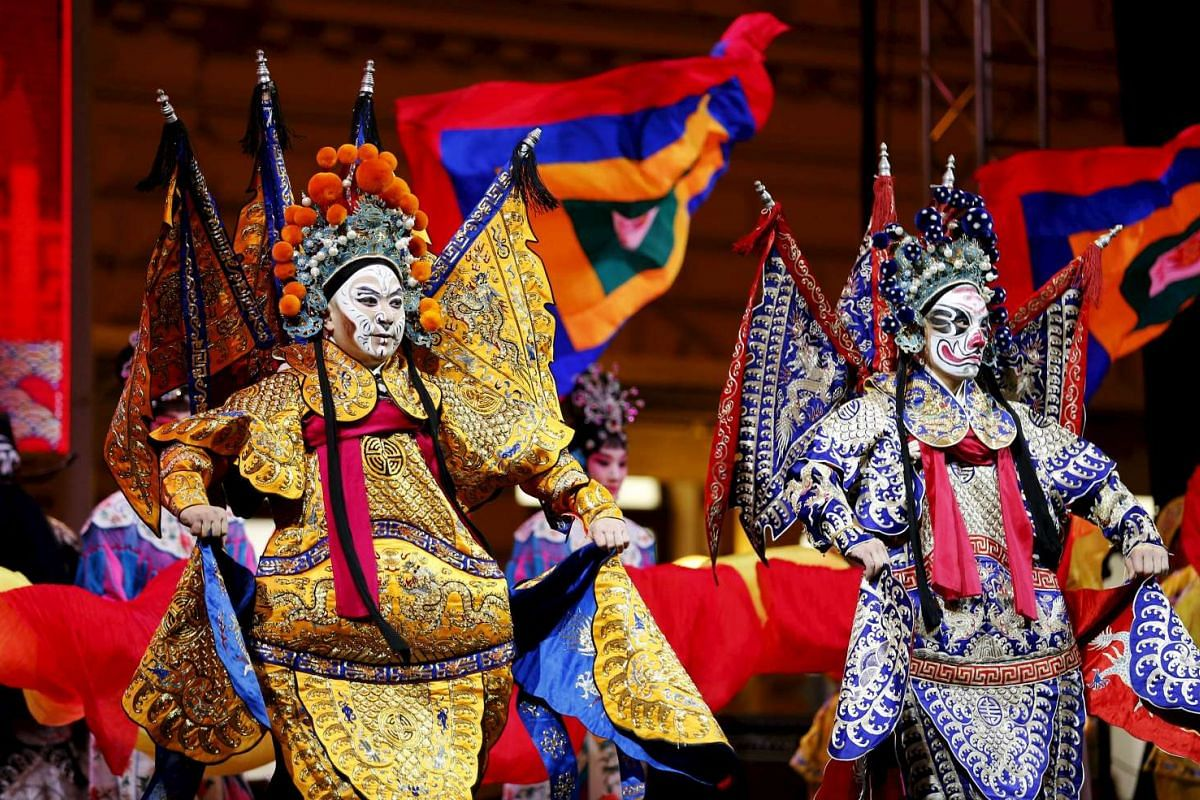 Chinese opera performers deck out in costumes for the upcoming Chinese New Year at Zagreb's main square, Croatia, on Jan 30, 2016.