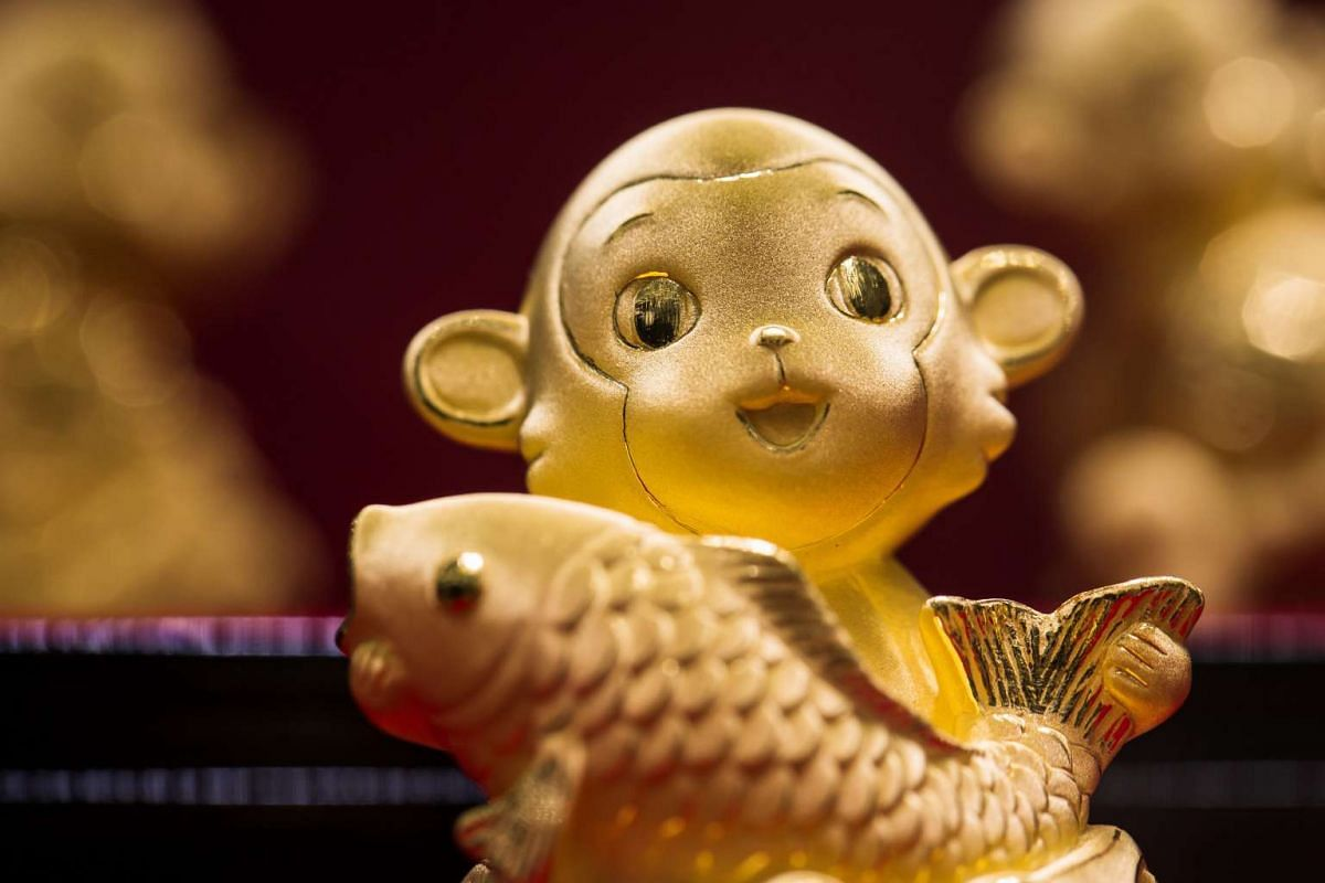 A gold monkey figurine sits on display at a Chow Tai Fook Jewellery store in Hong Kong, China, on Tuesday, on Feb 2, 2016.