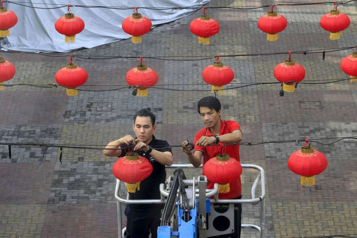 Workers install Chinese lantern decorations in preparation for the upcoming Chinese New Year celebrations in Chinatown in Manila, on Feb 1, 2016.