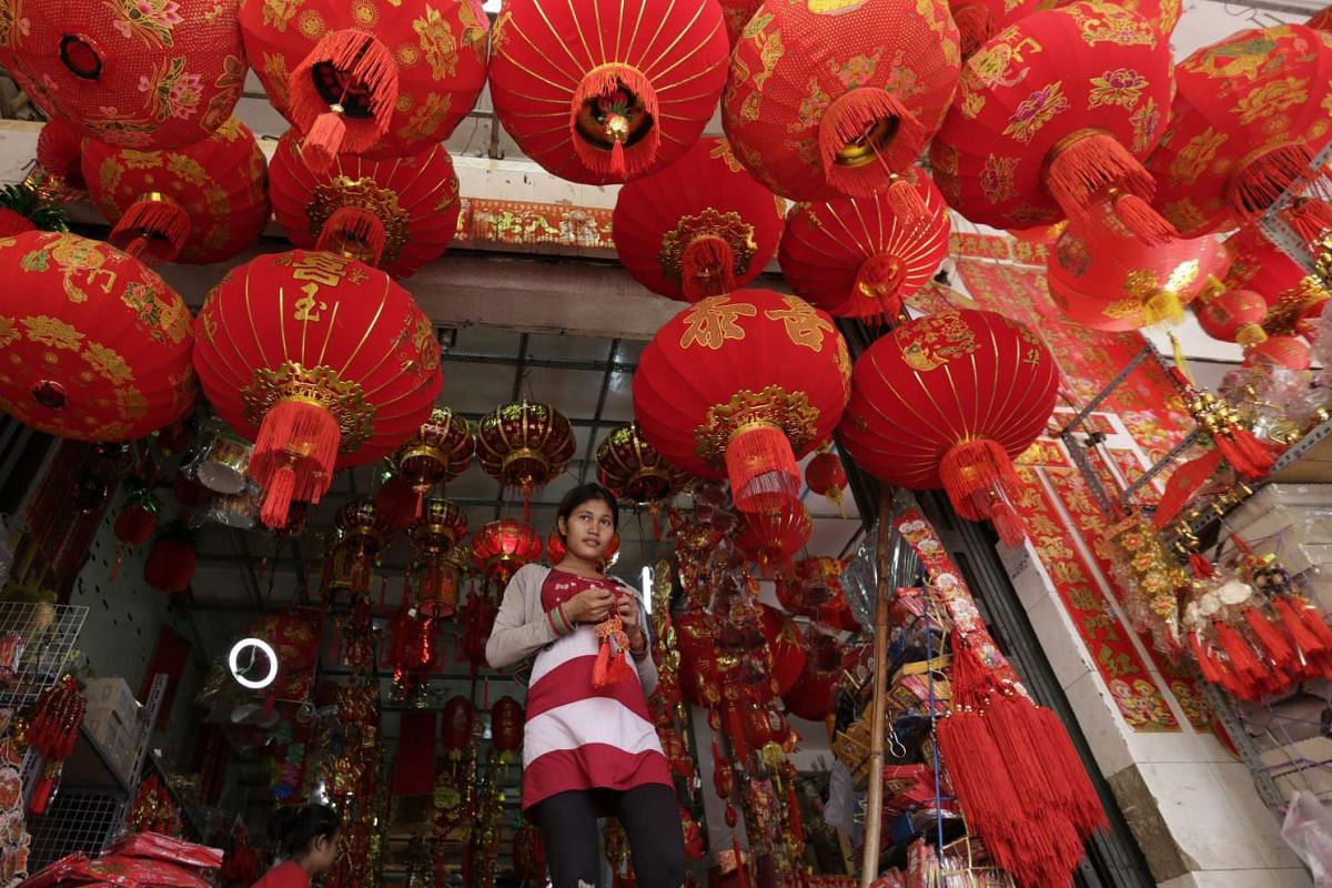 Cambodians sell Chinese New Year items at a street market in Phnom Penh, Cambodia, on Feb 2, 2016.