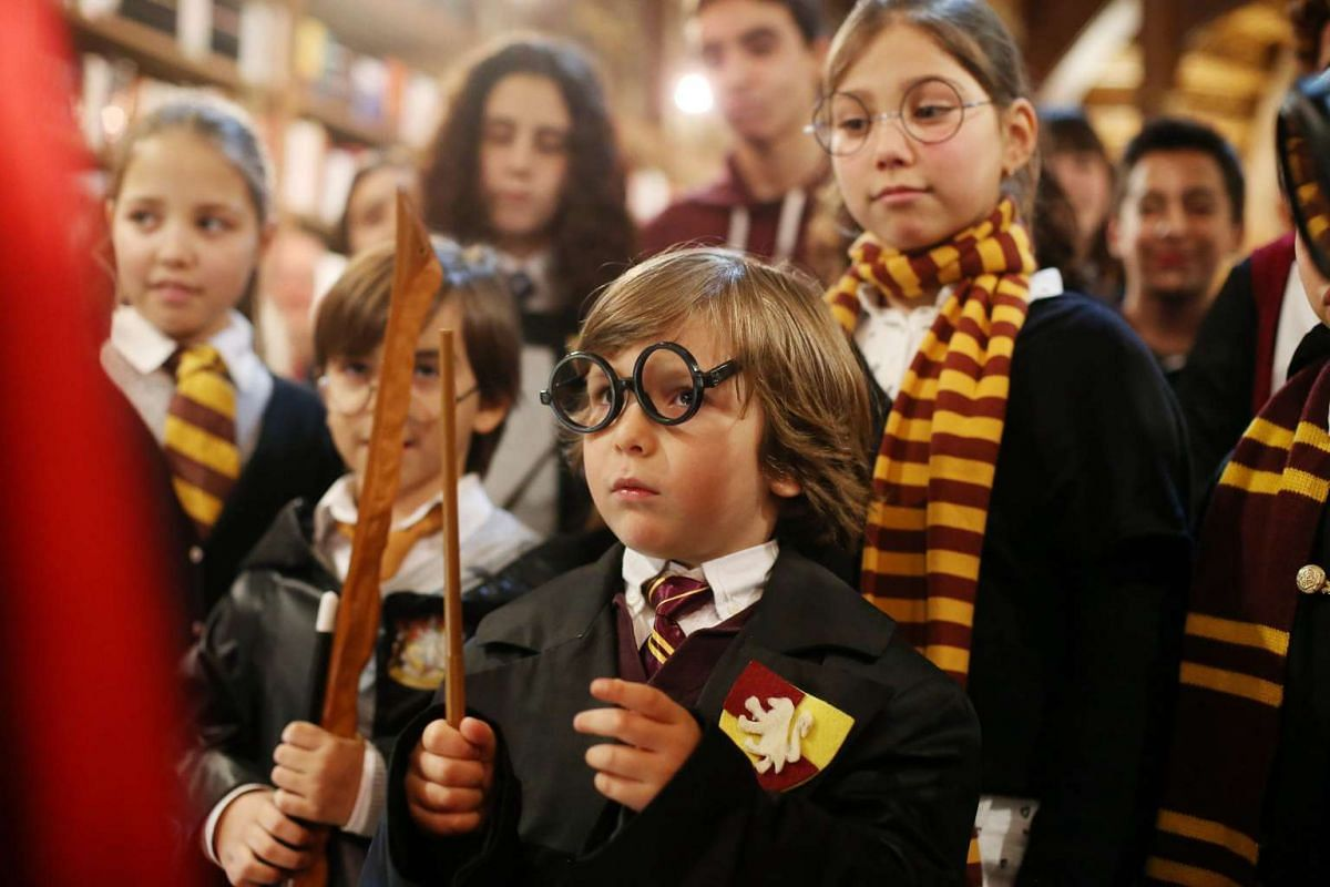 Children wearing costumes take part in the Harry Potter Book Night in Porto, Portugal on Feb 4, 2016.