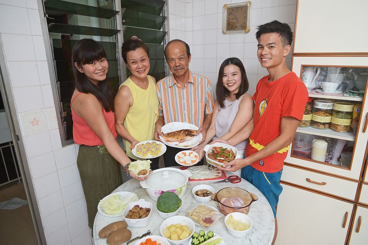 Ms Cheong Mei Xi (second from right), on her family's Chinese NewYear practices, which include making pencai filled with each family member's food contribution. With her are (from left) her sister, Mei Yan, mother, Mrs Suzanna Cheong, father, Mr