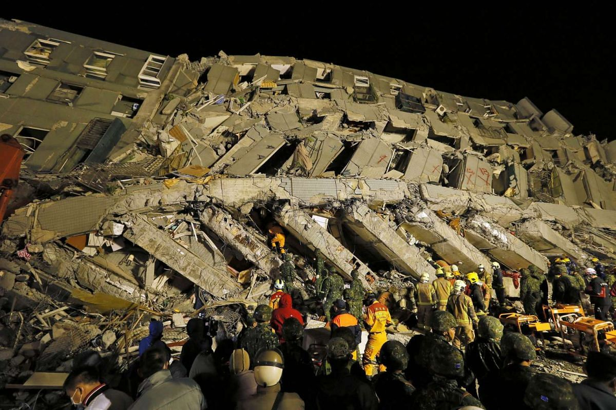 Rescuers continue to search for survivors from a collapsed building in Taiwan following an earthquake, on Feb 6, 2016.