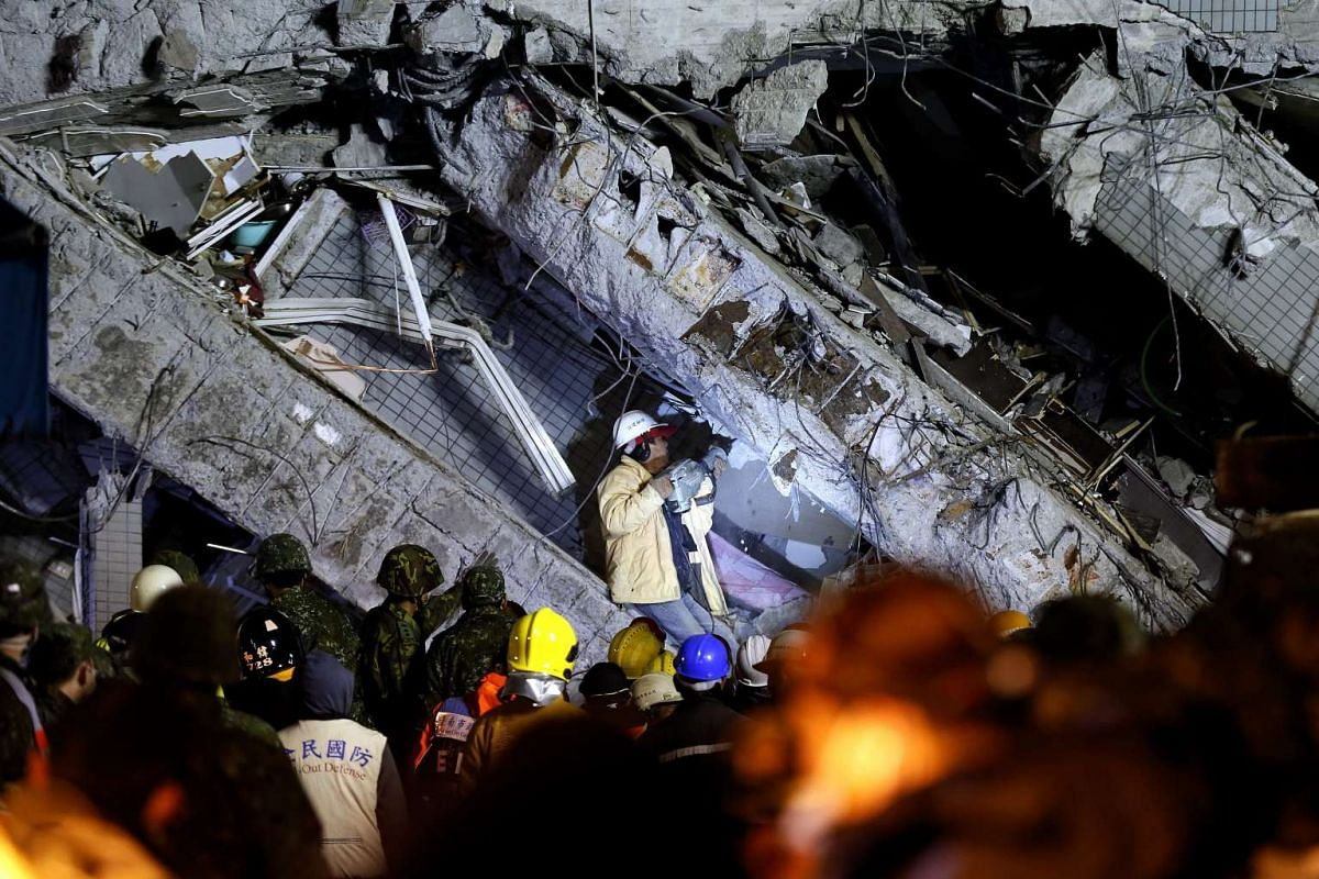 Rescuers continue searching for survivors trapped in a collapsed building in Tainan City, Taiwan, on Feb 7, 2016.