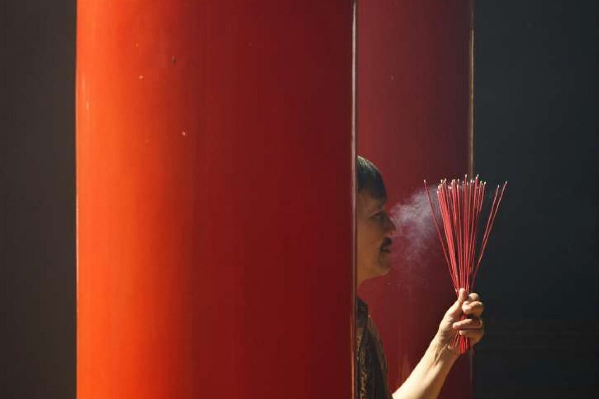 A man holding incense sticks during the Chinese New Year celebrations at a temple in Kuta, Bali, Indonesia, on Monday (Feb 8).