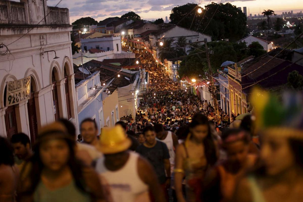 Revellers attending a carnival party in a neighborhood in Olinda, Brazil on Feb 7, 2016.