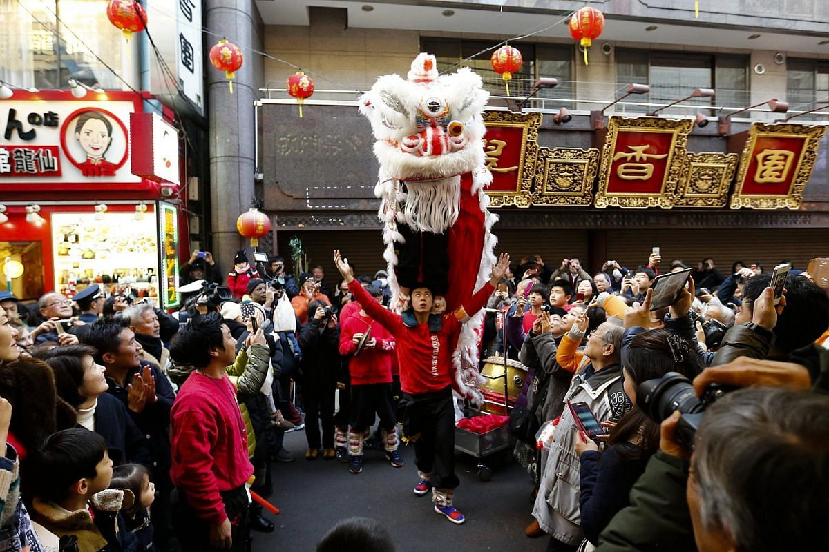 Men performing a lion dance outside a restaurant during the Chinese New Year celebrations in Chinatown in Yokohama, south of Tokyo, Japan, on Feb 8, 2016.