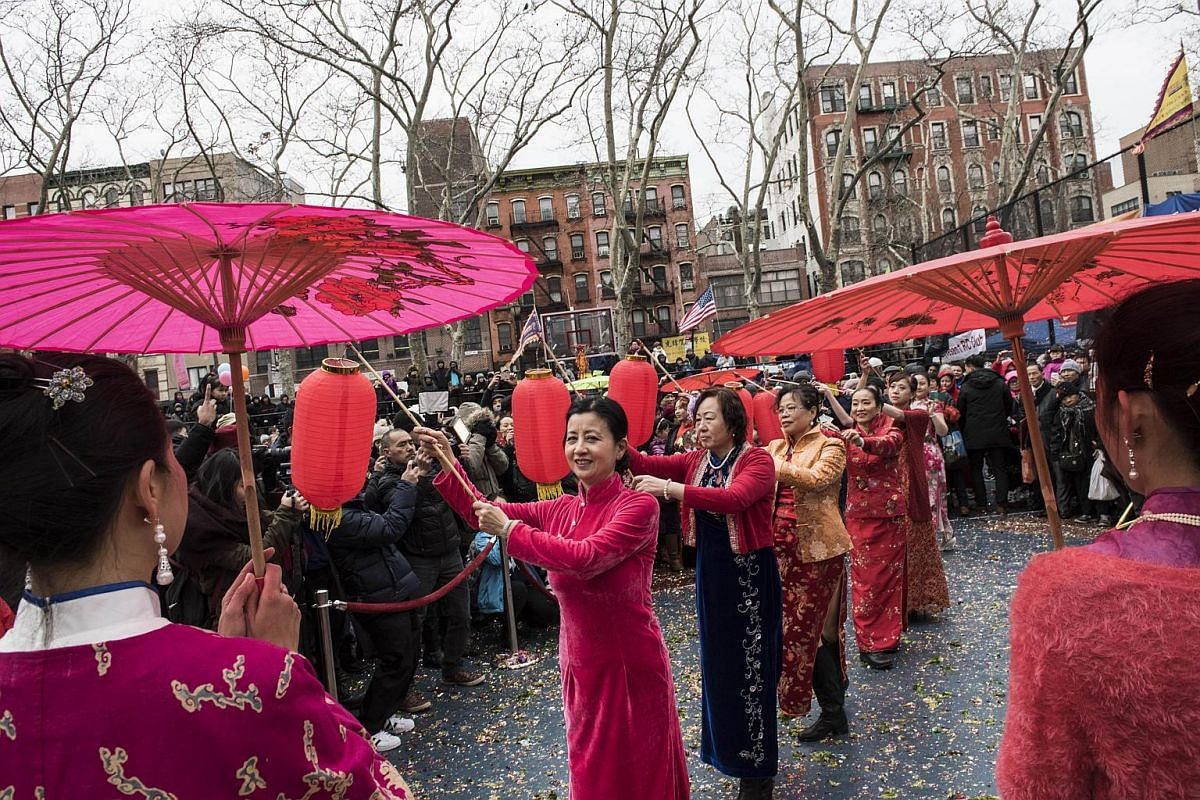 Women in traditional clothing from the South of China performing during the Chinese New Year celebration in Sara D. Roosevelt Park in Chinatown in New York on Feb 8, 2016.