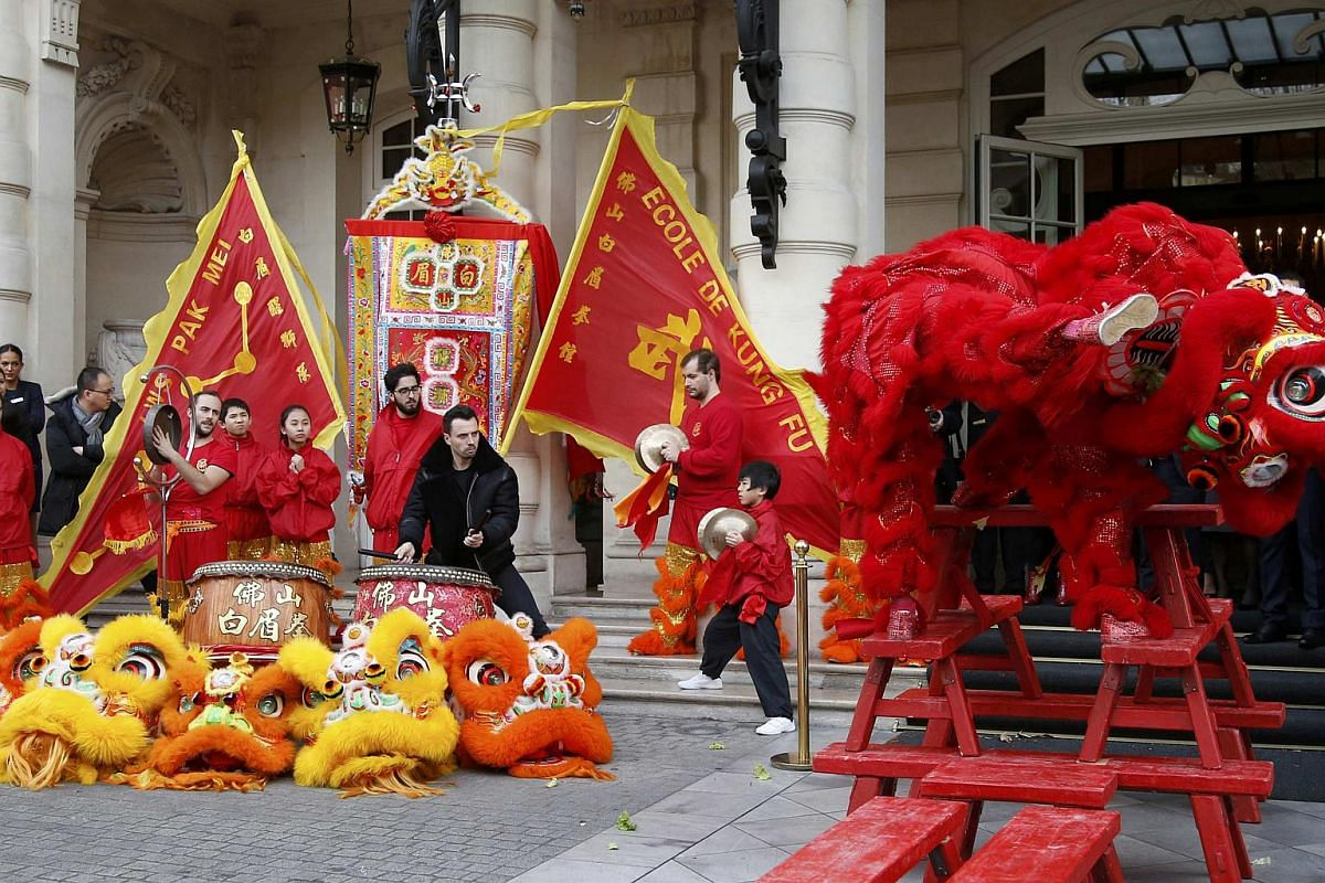 Members of the Pak Mei De Lao Wei San Kung-Fu school performing to celebrate Chinese New Year in front of the Shangri-La hotel in Paris, France, on Feb 8, 2016.
