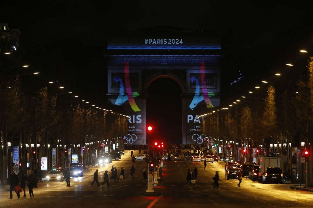 The official campaign logo of the Paris' bid to host the 2024 Olympic Games is seen on the Arc de Triomphe in Paris.