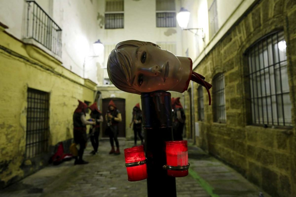 Revellers wait behind their set before performing during the Carnival of Cadiz in southern Spain.