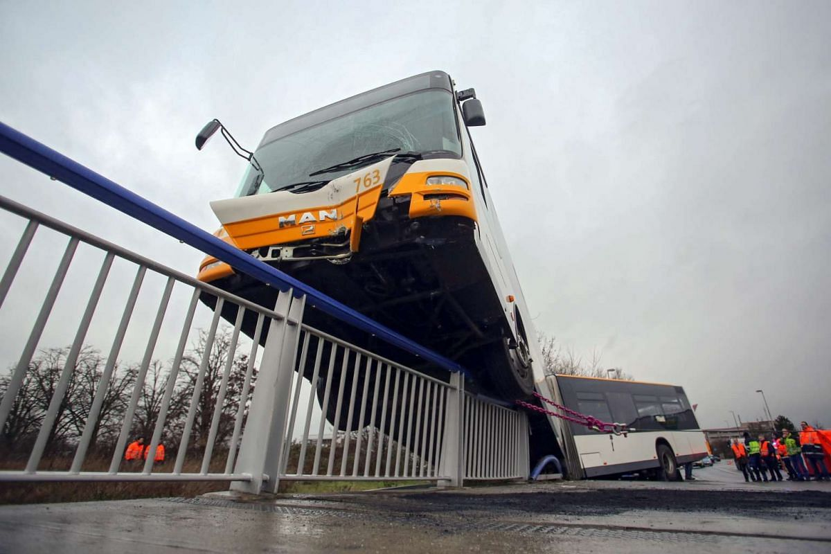 A Mainz Transport Company (BVG) public bus drove onto the railing of a highway overpass in an accident in Mainz, Germany, on Feb 10, 2016, injuring three people.