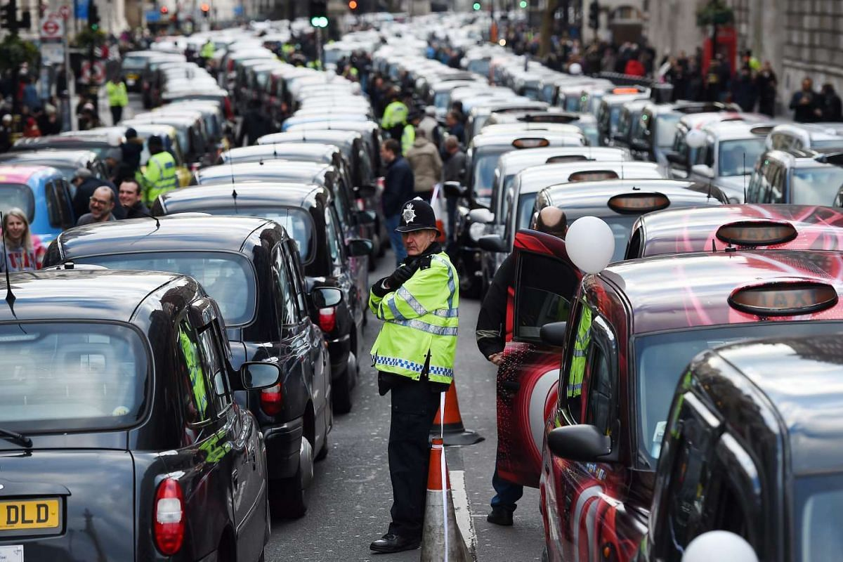Thousands of London black cab taxis block Whitehall during a protest against the Transport for London (TFL) decision to grant Uber taxis a private hire licence in central London on Feb 10, 2016.