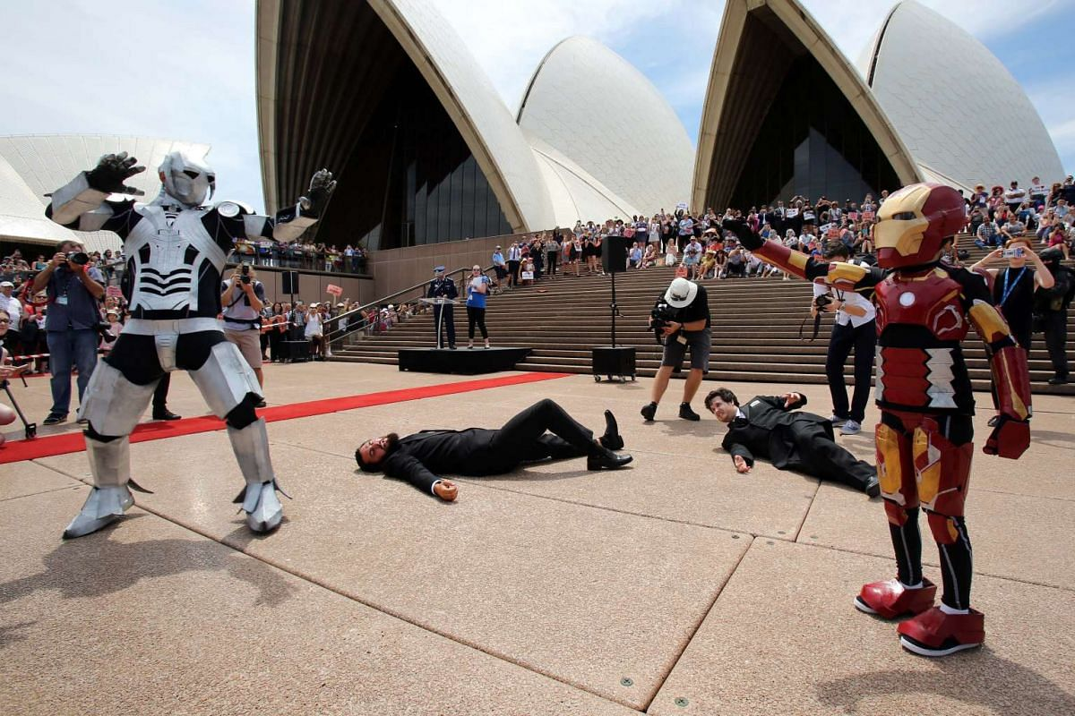 Nine-year-old Domenic Pace (right), who suffers from cystic fibrosis, acting out a scene as he is granted his wish to become a superhero like Iron Man at the Sydney Opera House on Feb 11, 2016.