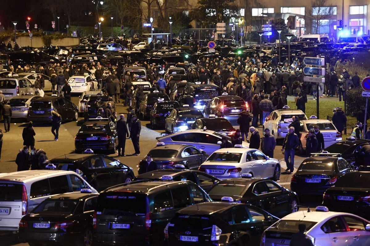 Parisian taxi drivers gather at the Porte Maillot during a nation-wide strike.