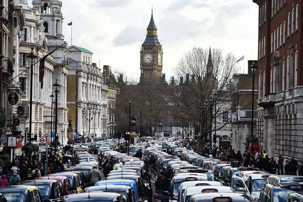 Thousands of London black cab taxis drivers block Whitehall during a protest in central London.