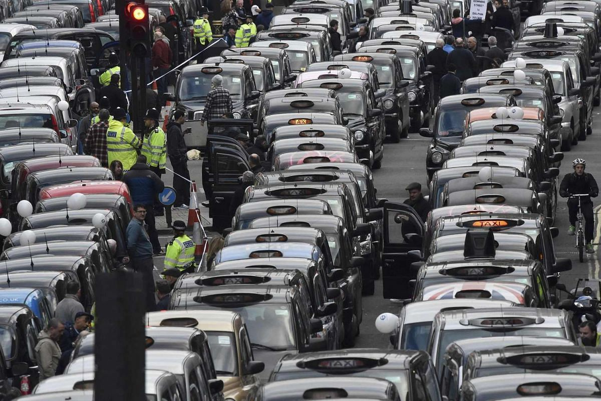London cab drivers protest against Uber in central London.