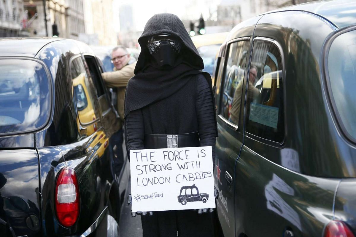 A London cab driver wears a Star Wars themed costume during a protest against Uber on Whitehall in central London.