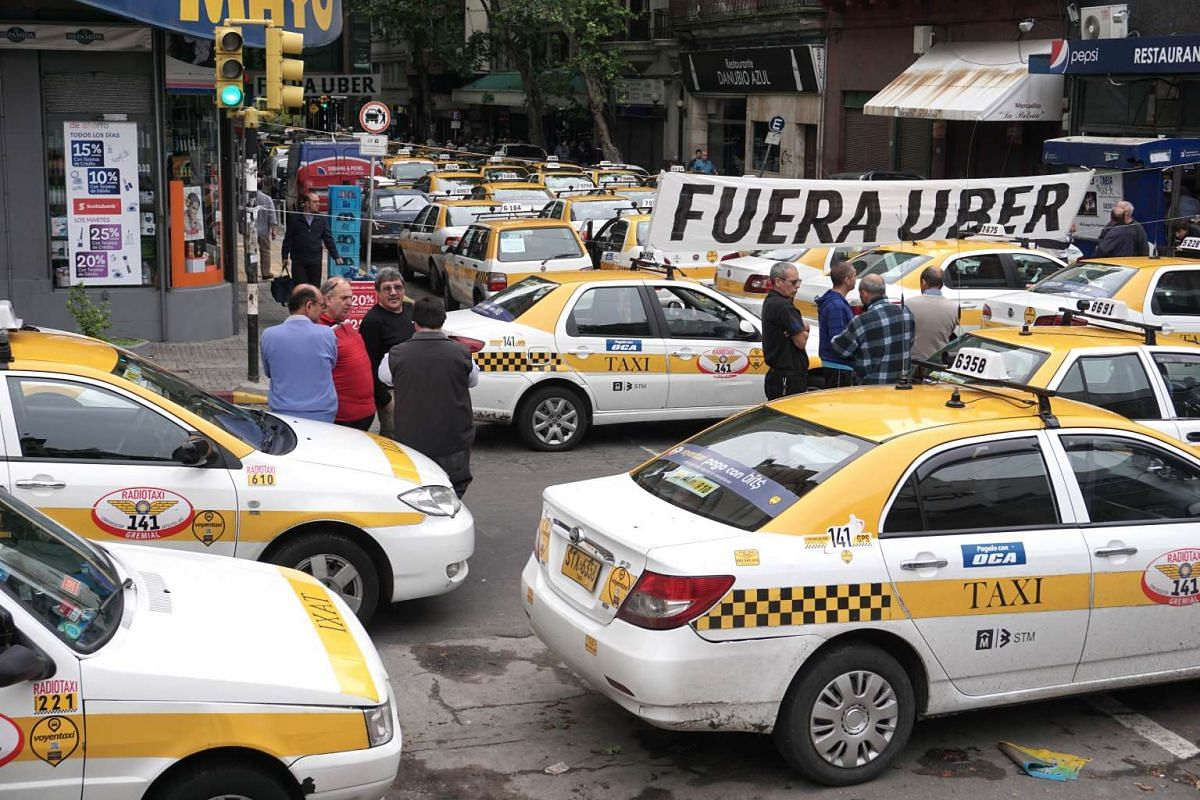 Taxi drivers block the street in front of the hotel where Uber is training drivers in Montevideo, Uruguay.