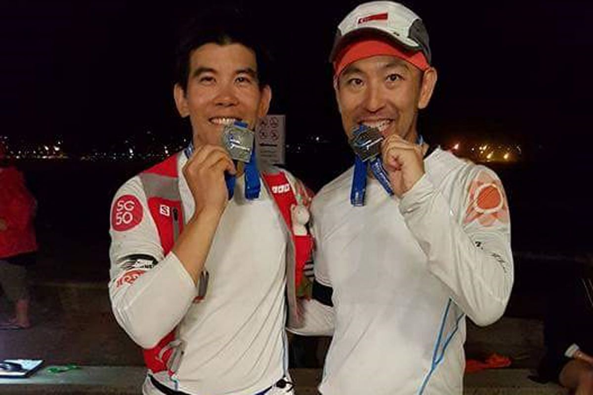 Cousins Ong Tze Boon and Ong Yu-Phing (left) in Miami, Antarctica, and Sydney (above), where they ran the last of their seven marathons in the World Marathon Challenge last month.