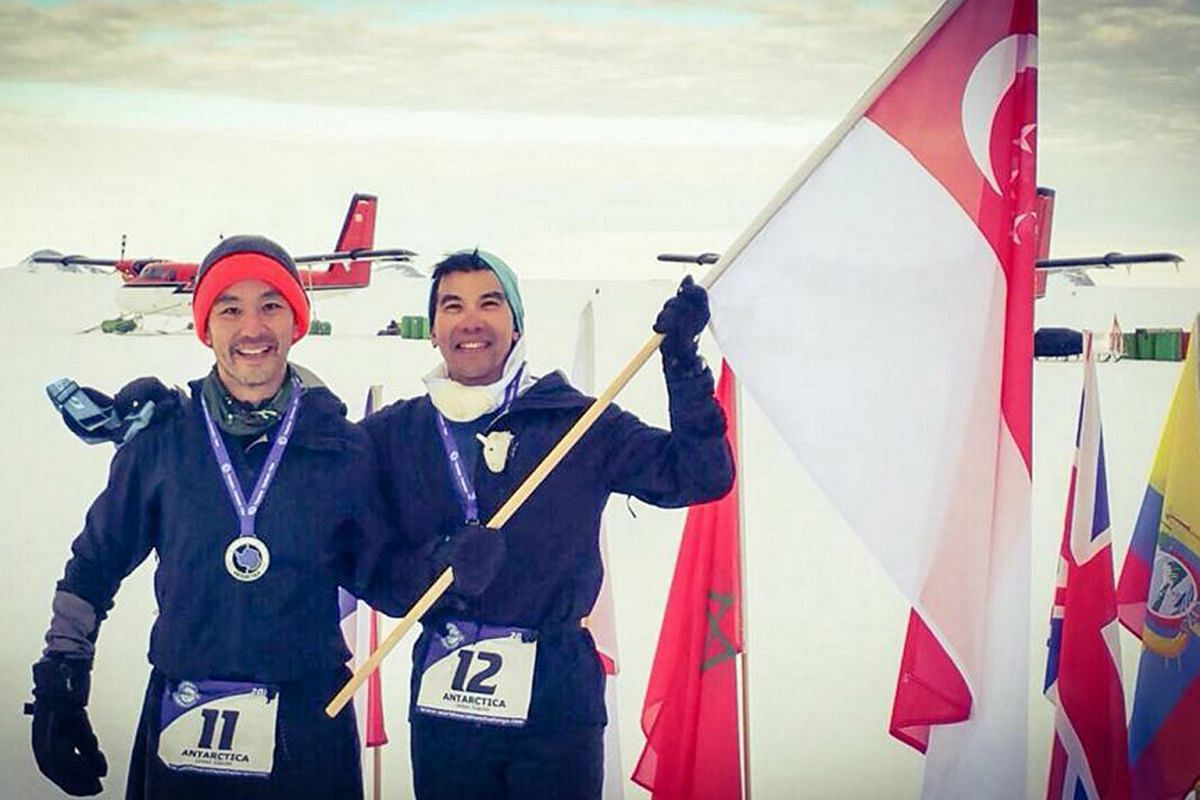 Cousins Ong Tze Boon (left) and Ong Yu-Phing in Miami, Antarctica (above), and Sydney, where they ran the last of their seven marathons in the World Marathon Challenge last month.