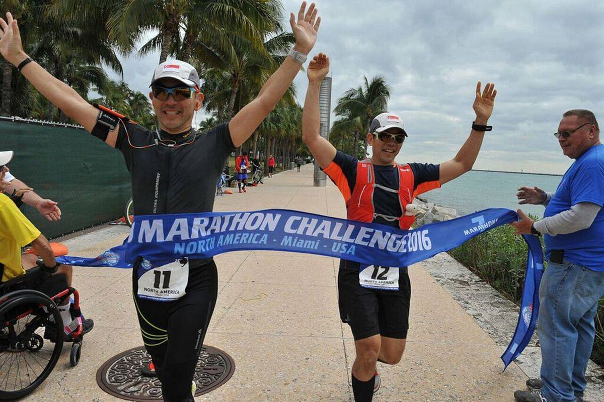 (Above): Cousins Ong Tze Boon (left) and Ong Yu-Phing in Miami, Antarctica, and Sydney, where they ran the last of their seven marathons in the World Marathon Challenge last month.
